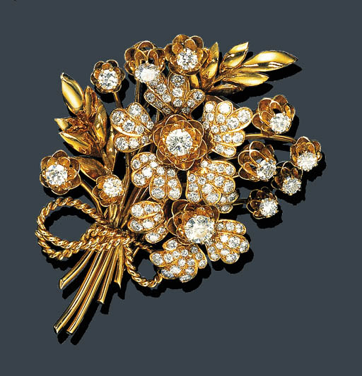 A DIAMOND AND GOLD FLORAL BROO