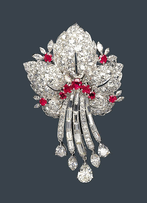 A DIAMOND AND RUBY BROOCH, RAY