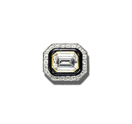 A FINE DIAMOND AND BLACK ENAME