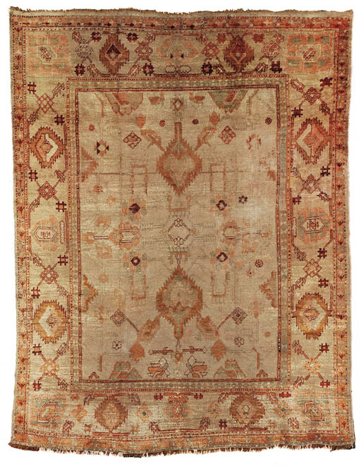 AN ANGORA OUSHAK CARPET