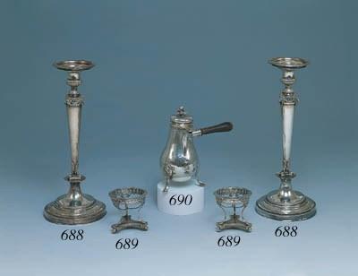 Coppia candelieri in argento,