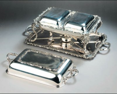 A silver-plated entree dish wi