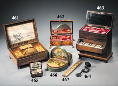 A PIANO SHAPED SEWING BOX
