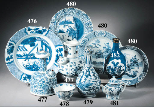 An assorted lot of blue and white dishes