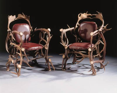 A pair of 'antler' armchairs