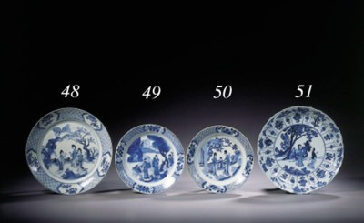 Eight blue and white plates
