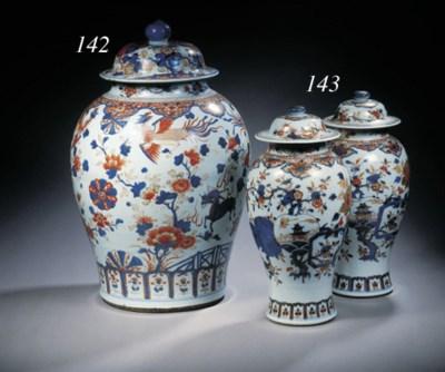 A pair of Imari jars and cover