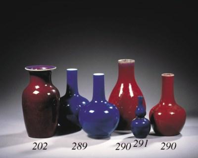 A pair of blue-glazed bottle v