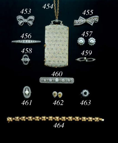 A WHITE-GOLD, DIAMOND AND CULT