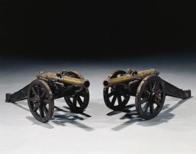 A pair of Dutch bronze miniatu