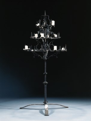 A wrought-iron candlestick