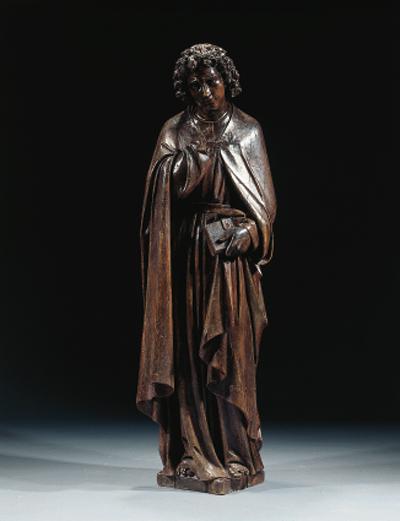 A carved oak figure of a Saint