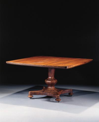 A mahogany dining-table