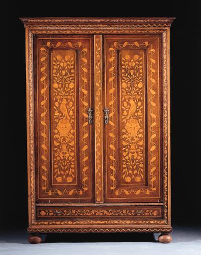 A mahogany and marquetry wardr