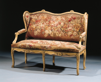 A winged giltwood and gilt-ges