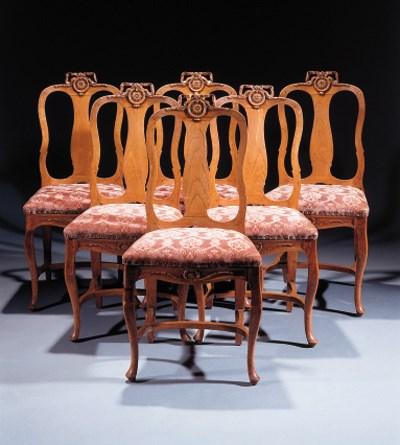 A set of six Dutch elm dining-