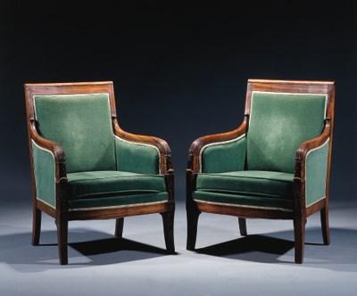 A pair of mahogany bergeres