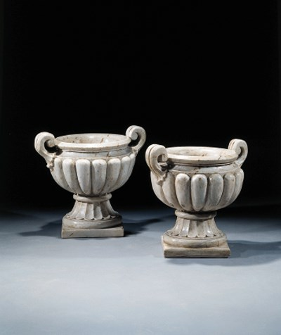 A pair of white marble vases