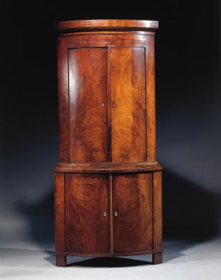 A Dutch mahogany corner cupboa