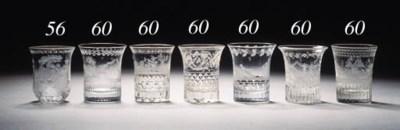 Four Bohemian-engraved beakers