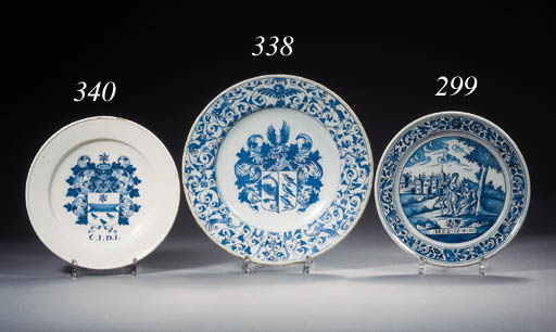 An early Dutch Delft blue and white armorial dish