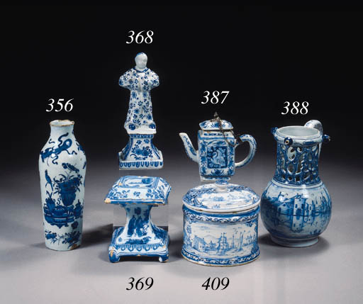 A Dutch Delft blue and white puzzle jug