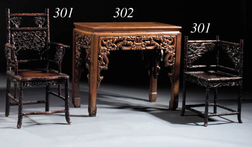 Two carved hardwood armchairs