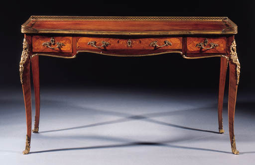 An ormolu-mounted rosewood satinwood and marquetry bureau plat