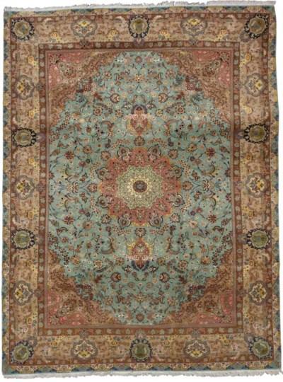 A fine part silk Tabriz carpet