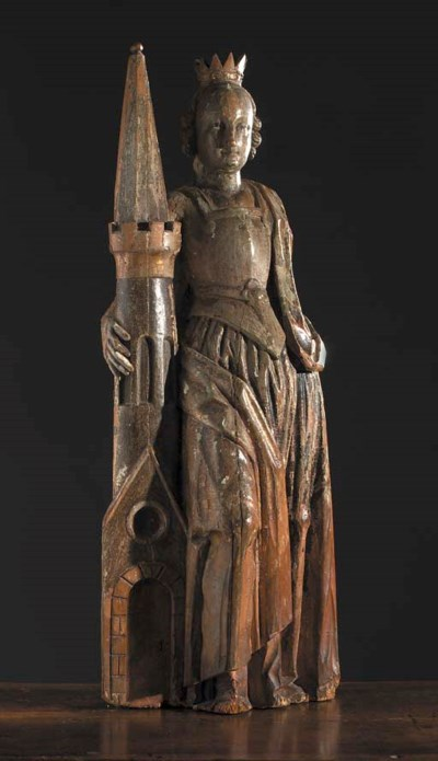 A polychrome carved wooden fig