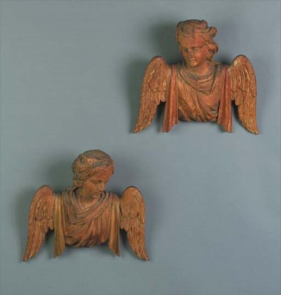 A pair of carved fruitwood ang