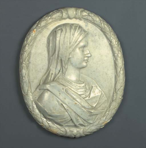 An oval carved marble portrait