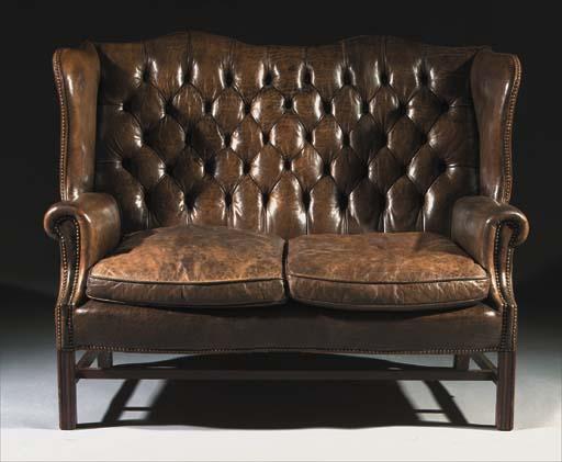 An English oak winged sofa