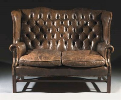 An English oak winged sofa