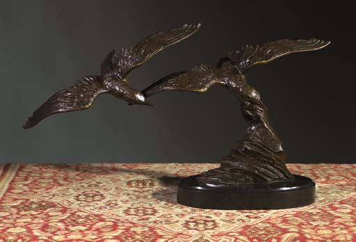 A bronze group of two birds