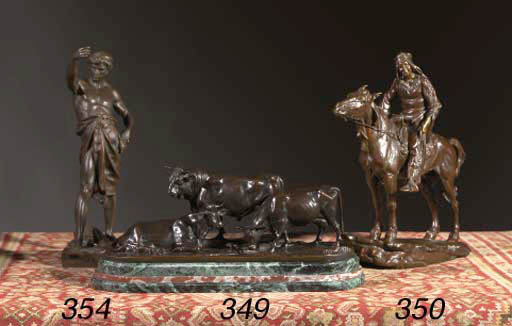 A bronze group of two cows and