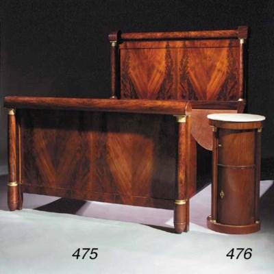A pair of Empire mahogany beds