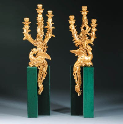 A pair of carved giltwood thre