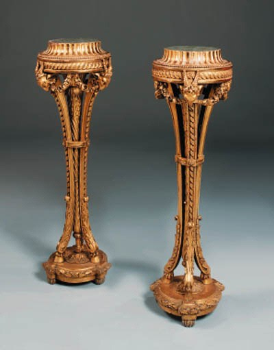 A pair of French giltwood stan