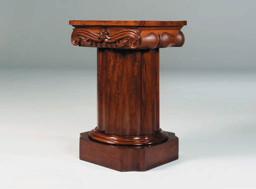 A GERMAN MAHOGANY PEDESTAL WAS