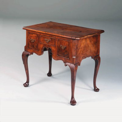 A GEORGE I WALNUT LOWBOY