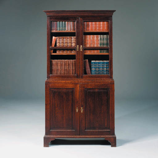 A GEORGE III OAK BOOKCASE