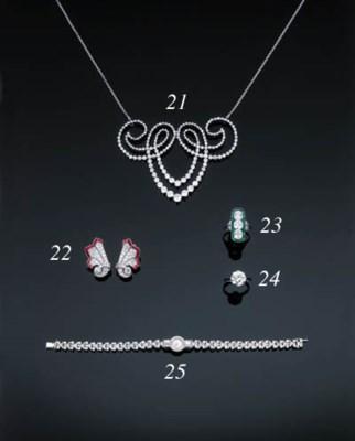 A Three-Stone Diamond And Emer