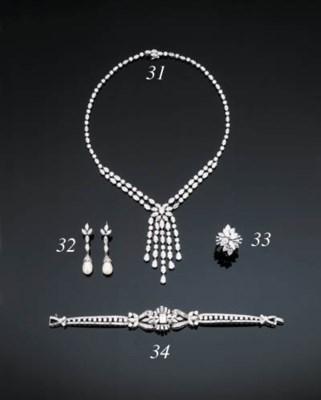A DIAMOND TASSEL NECKLACE BY C