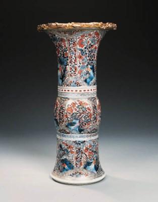 AN ORMOLU-MOUNTED BLUE AND WHI