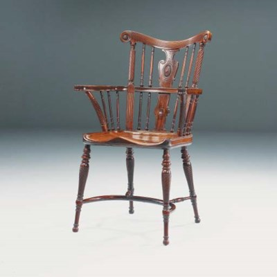 A MAHOGANY WINDSOR CHAIR