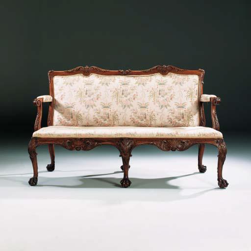 A GEORGE II WALNUT TWO-SEAT SO