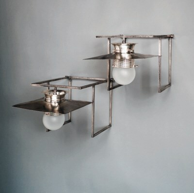 A pair of alpacca wall sconces
