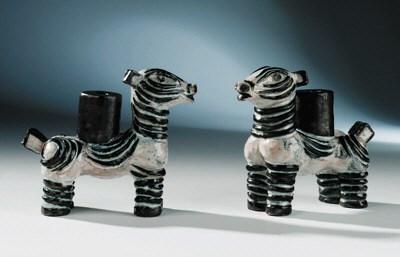 A pair of glazed terracotta la