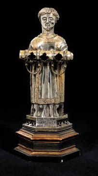 A SMALL PARCEL-GILT FIGURE OF
